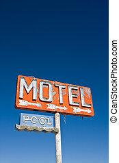 Vintage Motel Sign - An old vintage, neon sign points to a...