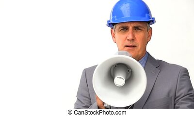 Businessman with safety helmet and megaphone isolated on a...