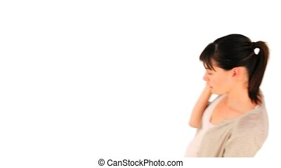 Young girl getting nervous on the phone against a white...