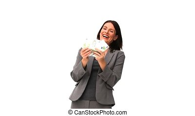Happy woman holding her cash isolated on a white background
