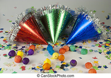 Carnival Hats and Confetti - Red Blue and Green hat on...