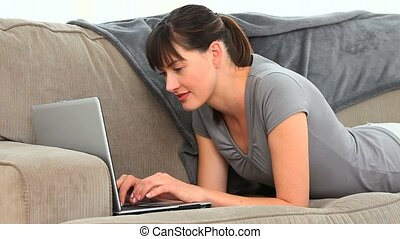 Casual woman chatting on her laptop