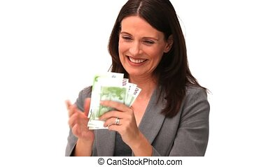 Businesswoman showing us her cash against a white background