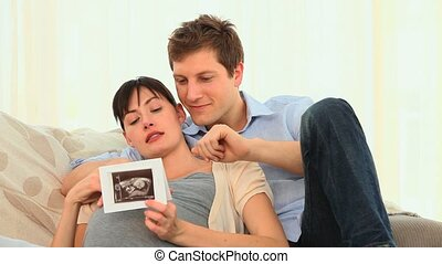 Attractive couple looking at a scan