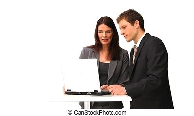 Business people using a laptop isolated on a white...