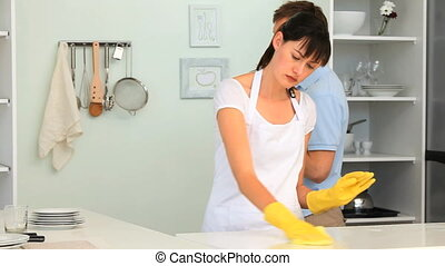 Brunette woman cleaning her kitchen