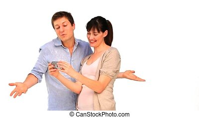Young couple taking a photo of themself