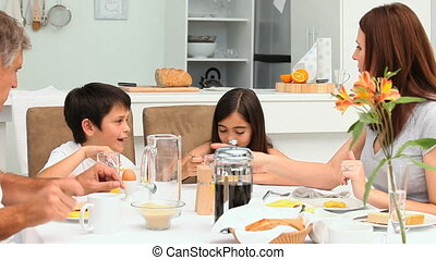 Family having a breakfast in the kitchen