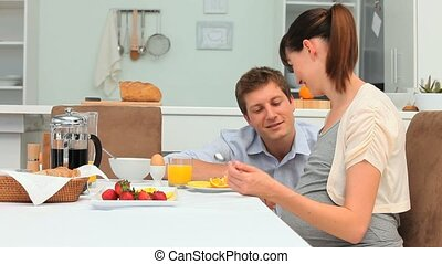 Young lovely couple taking the breakfast in the dinning room