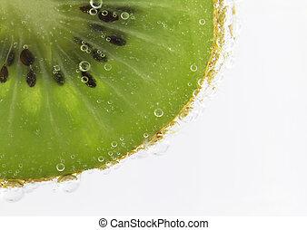 Refreshing Kiwi Fruit - Kiwi fruit slice submerged in...
