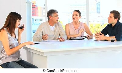 Casual business people having a discusion on a table