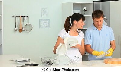 Couple washing up in the kitchen