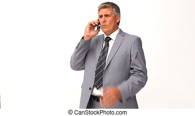 Man in suit getting nervous on the phone