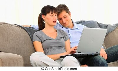 Lovely couple using a computer