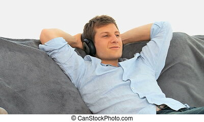 Relax man listening to music on his couch