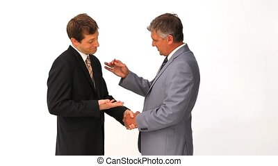 Businessman giving keys of a new home to another man against...