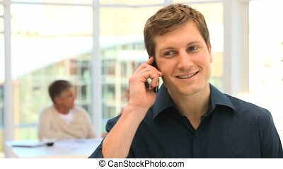 Young man speaking on the phone
