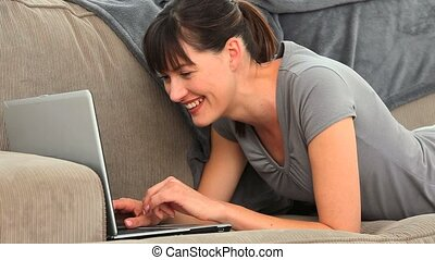Cute brunette chatting with a laptop