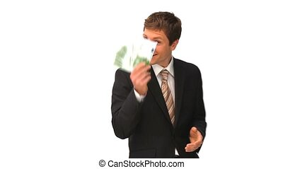 Businessman showing off his cash isolated on a white...