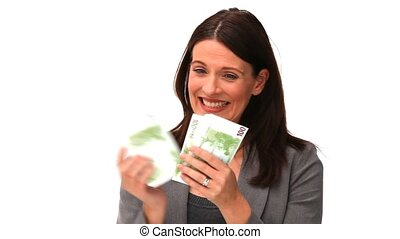 Brunette in suit counting her cash against a white...