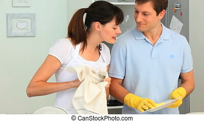 Couple doing the dishes in the kitchen