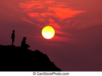 silhouette mother son - silhouette of mother and son on...