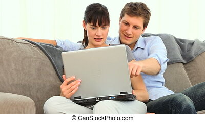 Happy young couple with a laptop