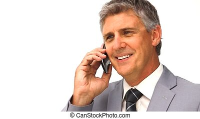 Businessman taking a phone call against a white background