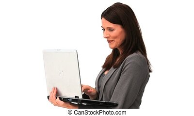 Business woman standing up with a laptop