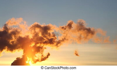 Smoke from pipe of termal power station at sunset