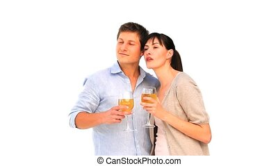 Cute couple enjoying a glass of wine isolated on a white...