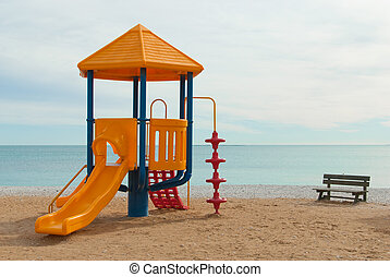 Chute - Colorful plastic chute on a beach playground