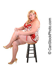 Big girl - An big overweight woman in beige lingerie putting...