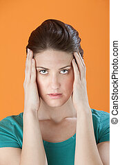 Woman Holding Head in Pain - Stressed out Caucasian woman...
