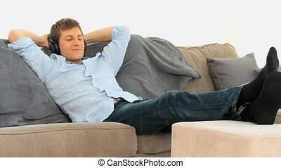 Relaxed man listening to music