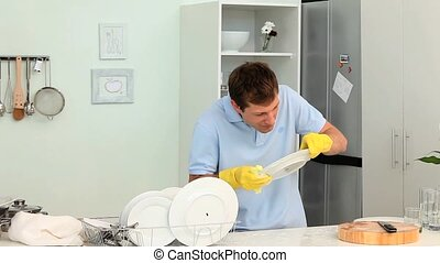 Fastidious man doing the dishes