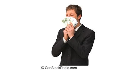Young businessman kissing his cash isolated on a white...
