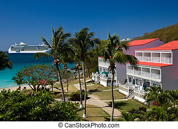 Cruise ship sails by vacation resort - Large cruise ship in...