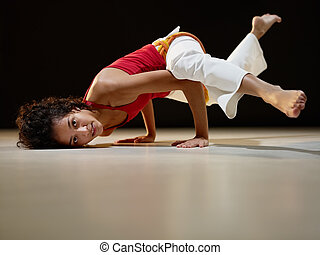 hispanic woman doing yoga exercise - portrait of young adult...