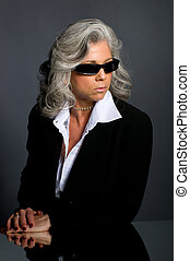 Executive Woman - Executive woman in her 50s wearing...