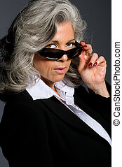 Executive woman looking - Executive woman in her 50s wearing...
