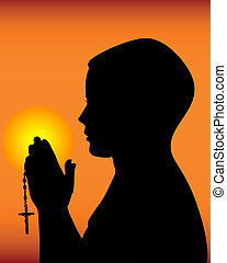 black silhouette of a praying on an orange background