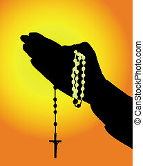 silhouette of hands with a rosary on an orange background