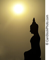 Buddha and sunset - Silhouette of Buddha statue at sunset in...