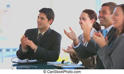 Business people applauding in an office