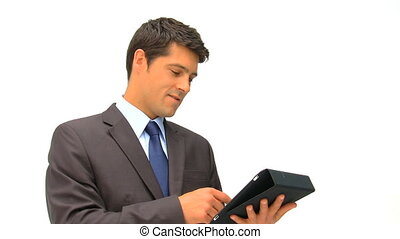Businessman checking his touch pad - Businessman checking...