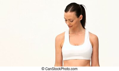 Woman doing exercises against a white background