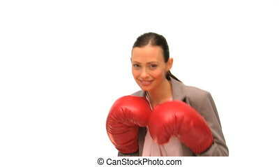 Brunette lady with boxing gloves isolated on a white...