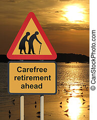 Carefree retirement ahead roadsign against a sunset...