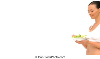 Woman in sportswear eating a salad